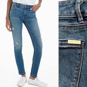 WHBM distressed raw hem skinny ankle denim jeans